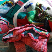 A pile of bright new blankets for folk who feel the cold, even in summer